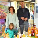Aidan O'Connor, Jackie Bowler and their daughter Eryn at their Maharees Juices market stall in Orchard Lane on Sunday. Photo: Declan Malone