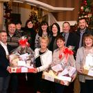 Pictured at the presentation of prizes in the Christmas in Killarney Massive Hamper Giveaway were from left, Paul O'Neill, Incoming President, Killarney Chamber of Tourism & Commerce presenting Breda McCarthy, Glenflesk, with the 1st prize hamper worth over €1,000. Also in photo are from left, Fergus Riordan, Killorglin, Bernie Gleeson, Killarney and Chris O'Brien, Killarney. At back, John McEnery, Organiser, Noreen Mangan, What Women Want, Dorane Hickey, MacBees, Anne Marie Kennelly, Committee Organiser, Tanya O'Shea, Easons, Paul Sherry, Killarney Outlet Centre and Tim Jones, Tim Jone Meats. Photo: Don MacMonagle