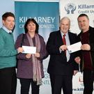 Shane Foley and Pat Delaney Chairman Killarney Credit Union presenting Kathleen Hickey and Pa Sugrue 2nd and 3rd prizewinners of the Killarney Credit Union Members Draw with the keys of the new Ford Ka with (left) Shane at Killarney Credit Union on Saturday. Photo by Michelle Cooper Galvin