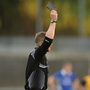 Referee Anthony Nolann shows the black card. Photo: Piaras Ó Mídheach/Sportsfile