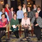 Clair Bowler, President Killarney Soroptimists, presenting €1,500 charity cheque to Peril O'Connell, Killarney Community Services, and Holy Cross Day Care Centre and Bridie Dillon, Rockmount Centre, Kilgarvan, (left) Anne O'Leary, (centre row from left) Terese Irwin, Catherine McMullen, Ann O'Connor, Catherine Gleeson, Killarney Soroptimists, Mai Godfrey and Ellen Callaghan, Rockmount Centre, Kilgarvan, (back from left) Noreen Ahern, Eileen Foley and Noelene O'Sullivan, Killarney Soroptimists, at the Gleneagles Hotel, Killarney
