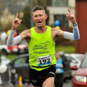 Glenbeigh's Chris Grayson raises his arms in celebration after winning the Clonakilty Waterfront Marathon at the weekend