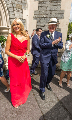 Miriam O'Callaghan and Tom McGurk emerge from the wedding service held in Kenmare
