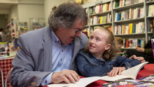 Doting granddad Gabriel Fitzmaurice with granddaughter, Katie Crowley, on the launch of his last work, Katie – poems inspired by the apple of his eye – in Woulfe's Bookshop, Listowel, in the pre-COVID days. Photo by Domnick Walsh