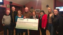 Con Carmody (centre) and family presenting a cheque for €6,000 to the Comfort for Chemo charity in Jack J's Bar, Asdee, last week – the proceeds of the recent table quiz held in the bar for the vital charity. FROM LEFT: quiz-master Tom Gorman; Con Carmody Jnr; Kathleen Carmody; Con Carmody Snr; Mary Fitzgerald and Amanda Coulson of Comfort for Chemo; Sarah Jane Carmody and Catherine Carmody