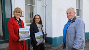 Valentia Islander, Míchael Lyne, presents his new book ' An tOileanac - the voices of Valentia' to note speakers President of MTU, Maggie Cusack, left and Canadian Ambassador to Ireland Nancy Smyth, at the 5th Annual Valentia Cable Foundation Lecture series which took place at the station on Valentia Island. Photo by Valerie O'Sullivan.