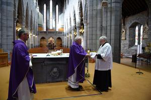 Bishop Emeritus of Kerry Dr William Murphy concelebrating Mass with Fr Niall Howard behind closed doors at St Mary's Cathedral, Killarney, with server Tadhgie Fleming attending