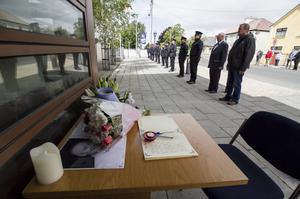 A book of condolences and floral tributes as serving and retired members of the force join to pay tribute to their fallen colleague, Detective Garda Coln Horkan, at Castleisland Garda Station as his Funeral service was being conducted in County Mayo. Picture: John Reidy