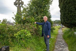 Cllr Sammy Locke making a point at the overgrow of hedges at Rath Cemetery. Photo by Joe Hanley