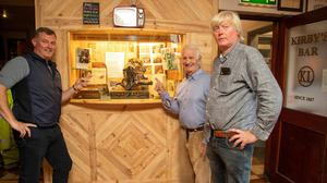 Remembering Christy Brown. Alan O'Sullivan, Tom Lawlor and Michael Leane point at the bronze bust of Christy Brown in Kirby's Bar, Ballyheigue. The late Christy was a regular in the bar when he lived in the popular seaside village in the late 1970s (Photo Joe Hanley).