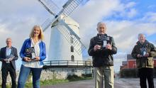 Radio Kerry presenter Deirdre Walsh launched photographer John Cleary's new book 'Every Picture Tells a Story' at Blennerville Windmill on Sunday with, from left, Kerry County Librarian Tommy O'Connor, Radio Kerry presenter Deirdre Walsh, John Cleary and Tommy King who compiled the book