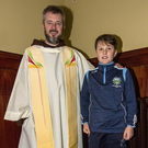 Fr. Bryan Shortall pictured with 'Miracle Baby' 11-year-old Jayden Foley from Farranfore at the first Padre Pio, Tuesday night novena at the Church of Saints Stephen and John. Photo by John Reidy