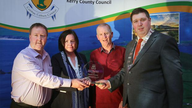 Cathaoirleach Kerry County Council Cllr Niall Kelleher, presenting Vincent O'Connor, Listowel, with his award, in recognition of his heroic rescue of John Kelliher(far left) in 1972, at the Kerry County Council Annual Awards on Friday night. Also included is Moira Murrell, Chief Executive of the Council. Photo: Valerie O'Sullivan