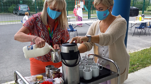 Listowel Family Resource Centre staff members Sylvia Hughes and Yvonne Dillon preparing the tea, sandwiches and treats for a tea party as part of a summer series of get-togethers.