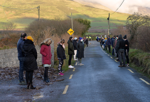 Mourners gathered at Tobar Cross on Monday afternoon in sympathy with the Harrison family following the tragic death of 17-year-old James Harrison at Bull's Head on Sunday. Photo by Declan Malone