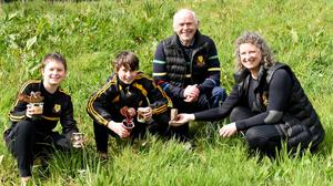 Cathal, Gearoid and Sinead Sugrue with (back) Eamonn Fitzgerald, Club Health Officer, planting the Wild Flower garden at Dr Crokes GAA Grounds, Killarney. Photos by Michelle Cooper Galvin