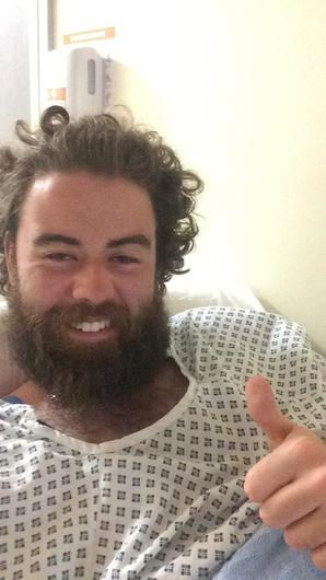 Ruairí McSorley gives the thumbs up from his hospital bed in UHK.