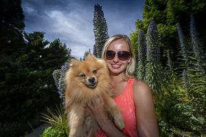 Lauren O'Shea and her dog Prince basking in the sun and colour at Liscahane Liscahane Nursery and Garden Centre on Tuesday