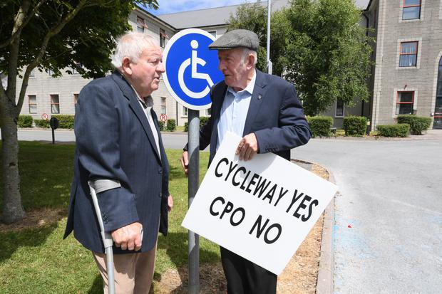 Jim Moriarty Glenbeigh and John Garvey from Cahersveen at the protest outside County Council buildings on Tuesday. Photo by Domnick Walsh