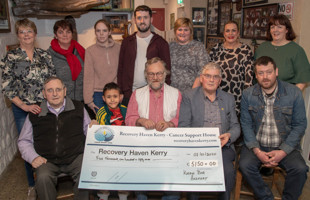 Eamon Kirby with family and friends as he presented a cheque of €5,150 to Recovery Haven, raised through his Movember beard shave late last year. Front, from left: Joe Egan, Eamon Kirby (grandson), Eamon Kirby, Dermot Crowley of Recovery Haven and Declan O'Connor. Back,from left: Olivia Murphy, Brenda and Nicole O'Connor, David O'Mahony, Mairead Kirby, Elaine Casey and Helen Geary. Photo by Joe Hanley