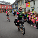 Tomás Mac a'tSaoir arriving home to a huge welcome in Baile an Fheirtéaraigh after cycling from Cairo to Capetown. He will be back on the road again shortly, this time cycling home from New Zealand