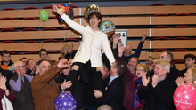 AjubilantNorma Foley is raised aloft by family,friends and supporters after her election to the Dáilwas confirmed atthe last countin Killarney on Sunday. Photoby Michelle Cooper Galvin