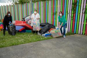 Catherine Casey, Kate Mallor and Emma O'Mahony of Adapt Refuge Centre, Tralee, on the clean up after the building was flooded on Sunday evening. Photo Joe Hanley