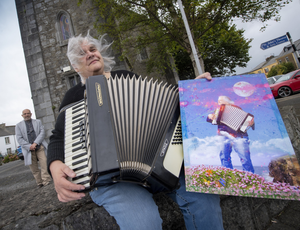 Ballybunion's Barbara Derbyshire with accordion in reality and in art. Photo by Domnick Walsh