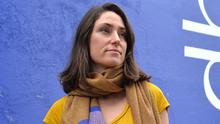 Fiadh Durham wearing one of her woven merino wool scarves outside her shop on Main Street. Photo by Declan Malone