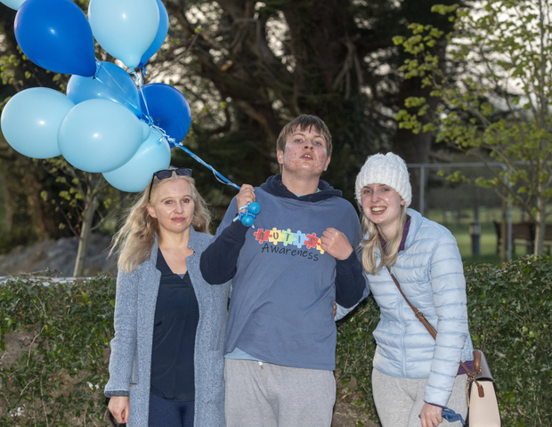 Noah Sheehan bearing blue balloons in the company of mom Deirdre and sister Aoife at Listowel Bridge on Friday. Photos by Domnick Walsh