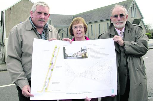 Tarbert Development Association members: Johnny Mulvihill, treasurer (left) pictured with Chairperson, Joan Murphy and committee member, John Fox with one of the drawings outlining the Tarbert Urban Design Framework on display at the community centre on Sunday morning. Photo: John Reidy