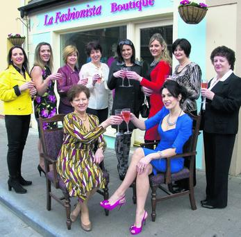 Here's to success: Catherine Keane (seated front) pictured with her mother Noreen Houlihan and mother-in-law, Teresa Keane (right) and supporters at the launch of her, La Fashionista Boutique on Listowel's Market Street on Friday morning. Included are from left: Arleen O'Doherty, Trish Chute, Clare Horgan, Maureen O'Sullivan, Deirdre O'Sullivan, Nollaig McEnery, Mary Dillon and Teresa Keane. Photo by John Reidy