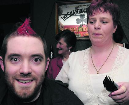 Padraig Hannafin from Ballyferriter with Joanne Houlihan shaving and dyeing his hair as part of the Shave Or Dye Fundraising event at Tigh U i Chathain, Ballyferriter.