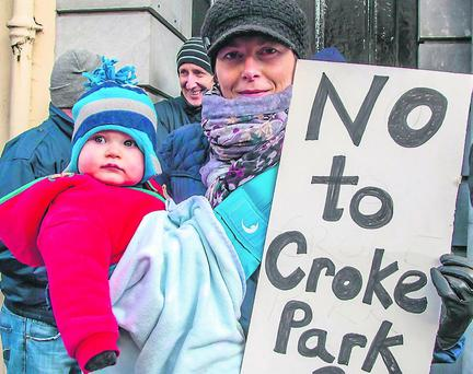 Susan Hudson, Tralee with 10-month-old Elliott at a public service workers protest in Denny Street, Tralee, on Monday