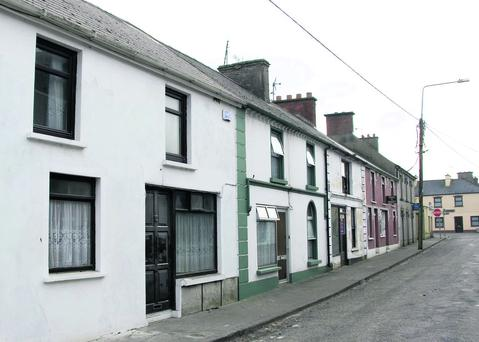 Teddy Kennelly's house (nearest to camera) on Ballylongford's Quay Street from which he was lucky to escape during last week's fire. Photo by John Reidy