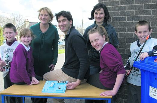Tidy Towns and science are part of daily life at Duagh National School. Pictured are guest science teacher Scott Ziglinski with principal Carmel Fitzgerald (left), teacher Mairéad White and pupils Megan O'Brien and Cathy Johnson. Photo: John Reidy