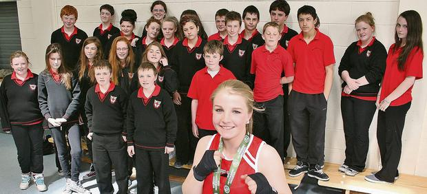 n All-Ireland boxing champion Marie McCarthy, pictured with her classmates in Meánscoil Nua an Leith-Triúigh.