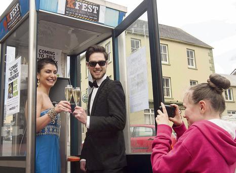 Red carpet and bubbles . . . Naomi O'Connor and Steve O'Donoghue get set for the premiere of 'Bye Bye Now' which will be screened in a phone box in Killorglin as part of the K-Fest music and arts festival this weekend. There are a host of activities lined up, see www.kfest.ie for more and Kfest on Facebook and Twitter.