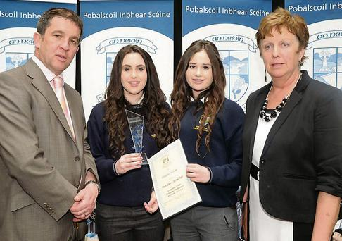 Pobalscoil Inbhear Scéine pupils Caitríona Harrington and Sophie Daly who received the Gradam Scéine Award from Dermot Healy Principal and teacher Judy O'Connor at the Pobascoil Inbhear Scéine School Awards on Friday.