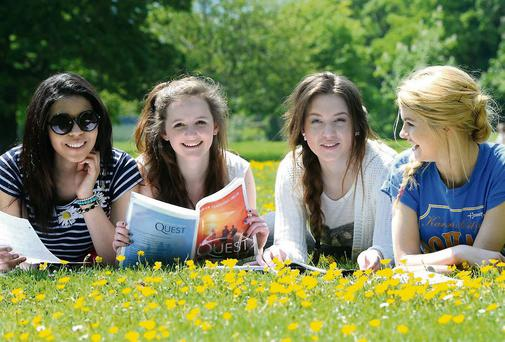 Exam students Emma Wade, Intermediate School Killorglin, Roisin Buckley, Killarney Community College, Kamile Pociute, Intermediate School Killorglin and Una Quill, St Brigid's Secondary School, Killarney getting in a little bit of study in the sunshine in Killarney National Park on Tuesday. Photo by Michelle Cooper Galvin