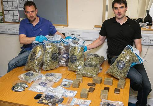 Gardai with the cannabis herb, cannabis resin, cocaine and a small amount of MDMA worth over €140,000 seized at a house in Ardfert last Friday.