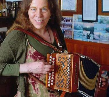 Cathy Cook with the distinctive accordion stolen from her van.