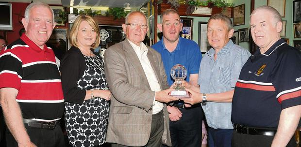 Tim Ryan, Chairman East Kerry Board (fifth from left), making a special presentation to Jimmy O'Brien on his retirement with his daughter Siobhan and son Jim, Johnny Brosnan Vice Chairman and Pat Delaney East Kerry Board at Jimmy O'Brien's Pub, College Street, Killarney.