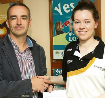 John Collins, Chairman Abbeyfeale Credit Union, presents a sponsorship cheque to Aislinn O' Connell,