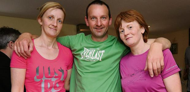 Una Devane, John Greaney and Ann Greaney inside Tom Crean's old house during the weekend.