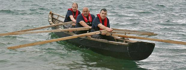 Maharees skippers Declan Griffin, Peter Hennessy and Tommy Griffin who plan to row from Clare to Kerry in a three hand currach this August in aid of Fenit Lifeboat Service. Photo by Marian O'Flaherty