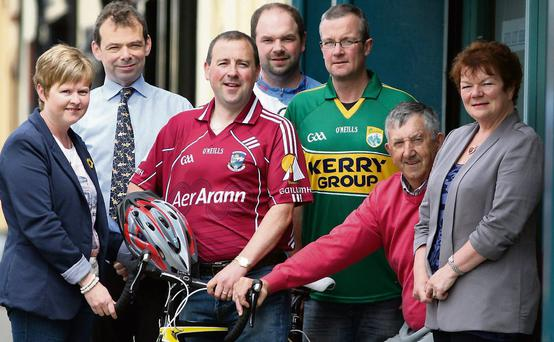 Charity cyclists: Centre from left: Liam Murphy, Donal Dennehy and Denis McCarthy are flanked by Catherine Judge-Murphy, organiser; Jack Shanahan, Kerry Hospice Foundation, Castleisland branch chairman; Dano and Nora Dennehy, Castleisland Motor Factors, joint sponsors at the announcement of details of the Kerry to Galway Hospice Cycle in Castleisland on Friday morning. Photo by John Reidy
