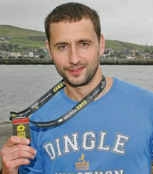 The first Kerryman past the finish line in the 2012 Kerryman Dingle Marathon, Cromane's Marcus O'Shea. Photo: Marian O'Flaherty