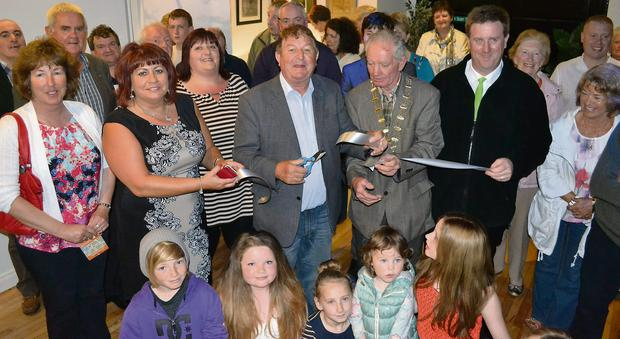 Dan Kiely cuts the tape to officially open Ballybunion's new tourist office.