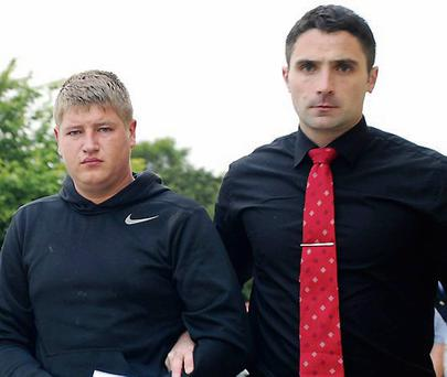 Eimantas Malinauskas (left) being led into a special sitting at Killorglin Court, Kerry by Detective Garda Eoin Donovan on Saturday. Photo: Michelle Cooper Galvin